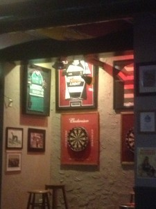 Some framed rugby jerseys where you can play some darts
