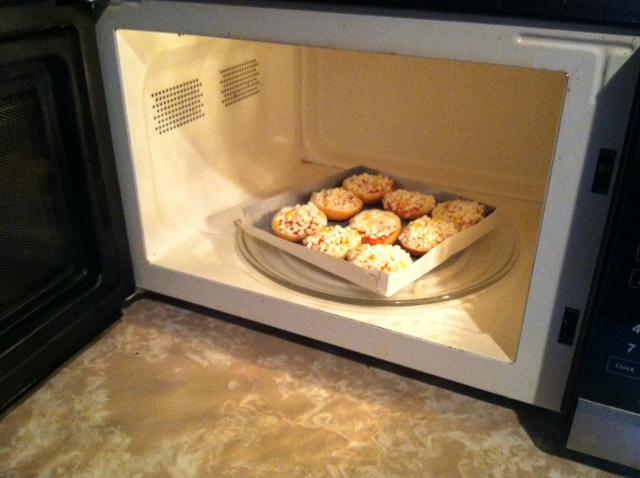 Bagel Bites and crisping tray inside the microwave. Photo by Katelyn Avery.
